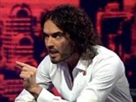 Russell Brand is open minded about conspiracy theories surrounding 9/11 terror attacks and asks 'Do you trust the American Government?'
